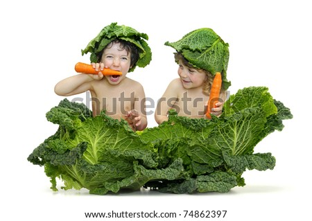 Beautiful children inside a cabbage eating carrots - stock photo