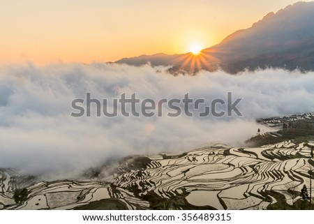 Beautiful China Yunnan Yuanyang terraces sunrise - stock photo