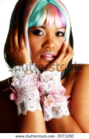 Beautiful chinese indonesian woman, in artist make-up and colorful wig. - stock photo