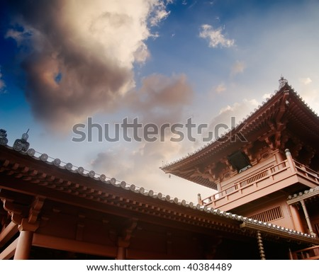 Beautiful Chinese traditional temple structure made by wood with blue sky. - stock photo