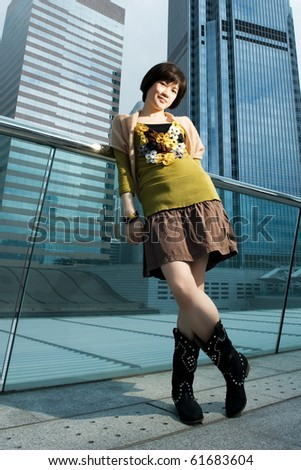 Beautiful chinese woman having fun outdoors - stock photo