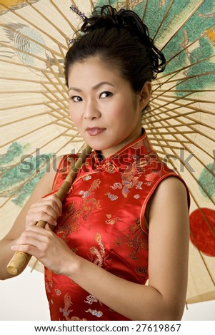 Beautiful Chinese woman in traditional Chinese clothing - stock photo