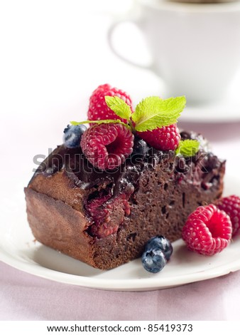 Beautiful chocolate cake with fresh berry. Selective focus - stock photo