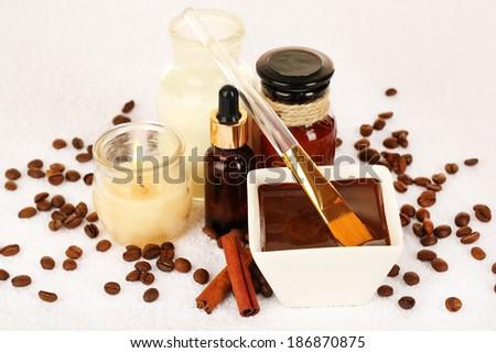 Beautiful chocolate spa setting on towel close-up - stock photo