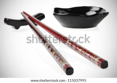beautiful chopsticks, isolated on white backgrounds - stock photo