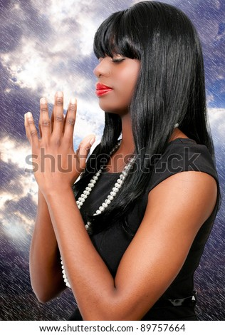 Beautiful Christian woman in deep prayer - stock photo