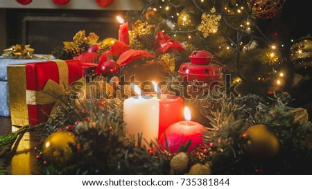Beautiful Christmas Background With Burning Candles On Advent Wreath At Living Room