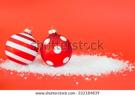 Beautiful christmas balls on red background