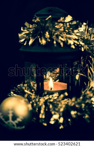 Beautiful christmas composition with Christmas ball and candle on a dark background