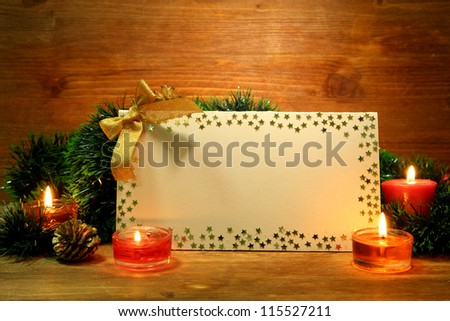 beautiful Christmas composition with empty postcard on wooden background - stock photo