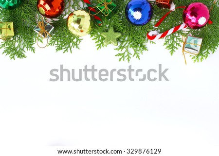 Beautiful Christmas decoration and pine leaves on white background  - stock photo