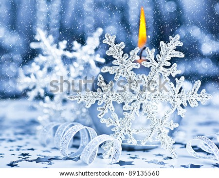 Beautiful Christmas decoration, blue holiday background with candle light & snowflake, winter holidays celebration, soft focus - stock photo