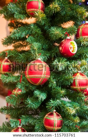 Beautiful Christmas fur-tree decorated with New Year's toys - stock photo