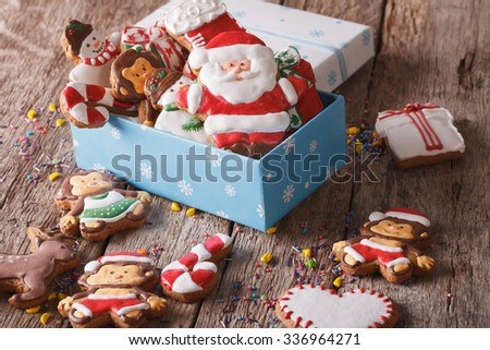 Beautiful Christmas gingerbread cookies in a gift box on a table close-up. horizontal