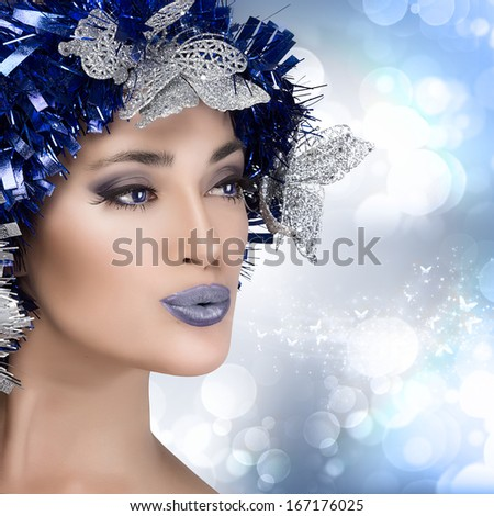 Beautiful christmas girl with festive makeup and hairstyle in blue and silver - stock photo