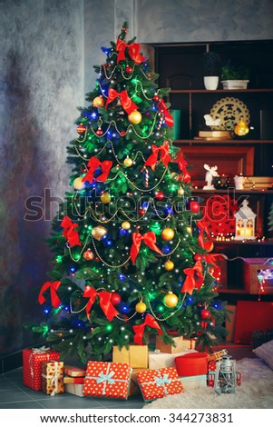 Beautiful Christmas interior with decorated fir tree - stock photo