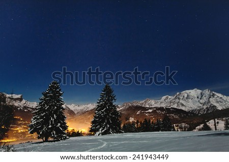 beautiful christmas landscape with night stars on blue winter sky - stock photo