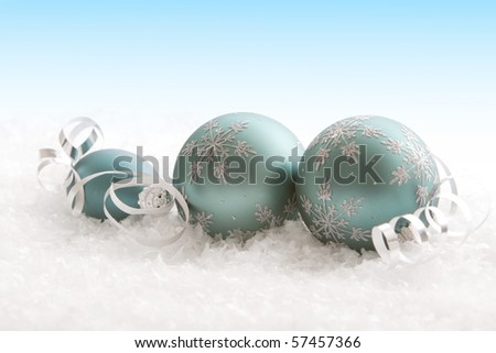 Beautiful Christmas ornaments and ribbons in snow