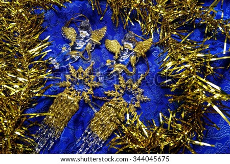 Beautiful Christmas ornaments with gold snowflakes and angels on a blue background/Christmas beautiful decorations/Christmas theme