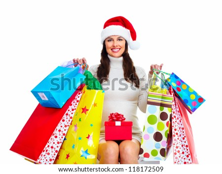 Beautiful Christmas Shopping woman with bags isolated on white background. - stock photo