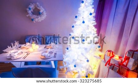 Beautiful Christmas table setting with blue and white decoration