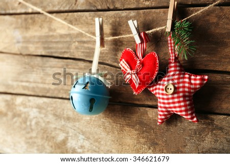 Beautiful Christmas toys on old wooden background - stock photo