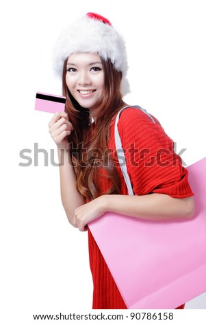 Beautiful Christmas woman happy take credit card and shopping bag isolated on white background - stock photo