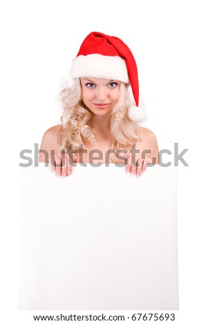 Beautiful christmas woman in santa hat holding empty blank