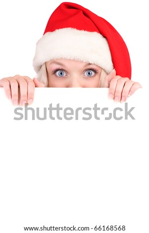Beautiful christmas woman in santa hat holding empty board