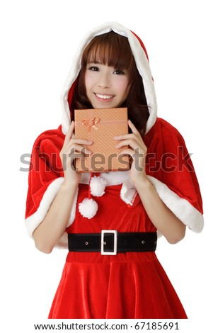 Beautiful Christmas woman of Asian holding gift box and smiling over white. - stock photo