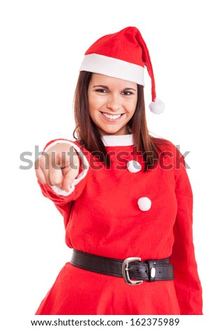 Beautiful Christmas woman pointing front