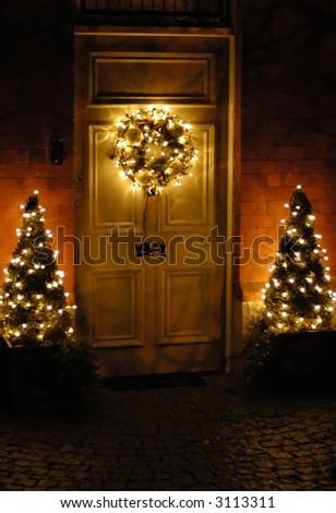beautiful Christmas wreath hanging on the doors - stock photo