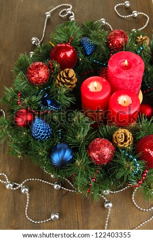 Beautiful Christmas wreath on wooden table close-up - stock photo