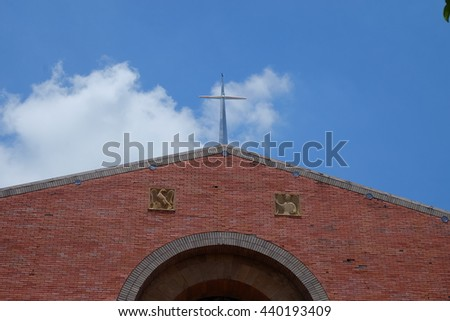 Beautiful church in the background of blue sky - stock photo