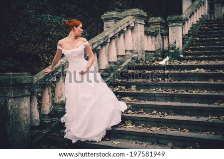 beautiful cinderella bride on stairs - stock photo