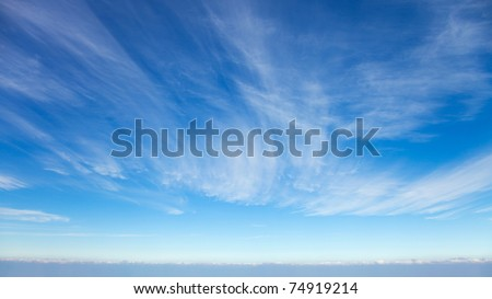 Beautiful cirrus clouds against the blue sky - stock photo