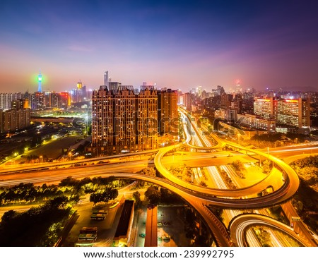 beautiful city flyover at night , aerial view of overpass junction in guangzhou   - stock photo