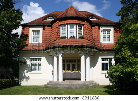 Beautiful city house on a sunny summer day - stock photo