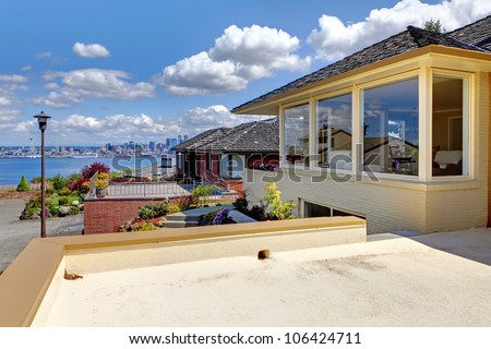 Beautiful city house with water view and Seattle downtown. - stock photo