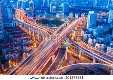beautiful city interchange closeup at shanghai yanan west road in nightfall  - stock photo