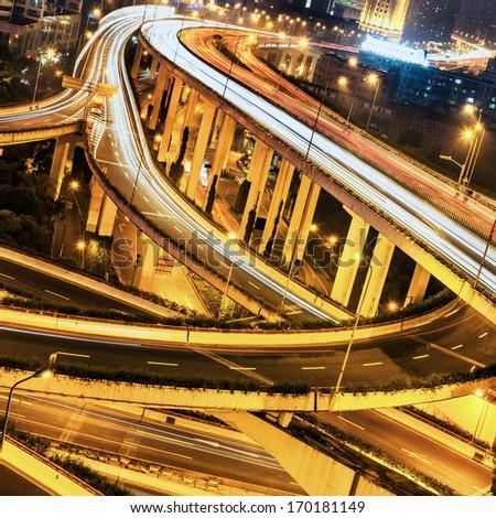 beautiful city interchange overpass at nightfall in shanghai - stock photo