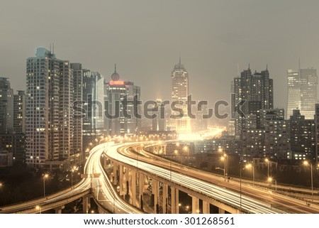 beautiful city interchange overpass at nightfall in shanghai - stock photo