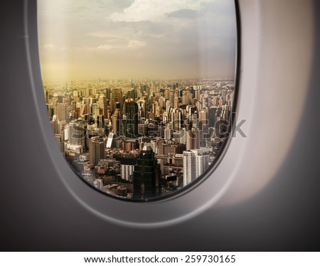 beautiful city view of Bangkok with blue sky from plane window - stock photo