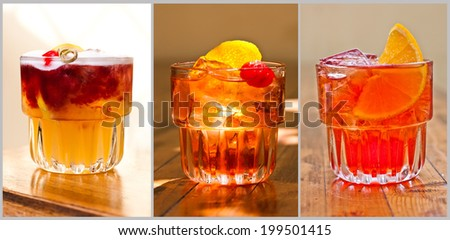 Beautiful classic cocktails. New York Sour, Negroni, Martinez. Wood background. - stock photo