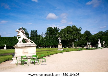 Beautiful classical statue in the Tuileries Garden, Paris, France with blue sky