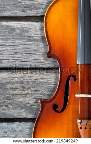 beautiful classical violin on old wood background