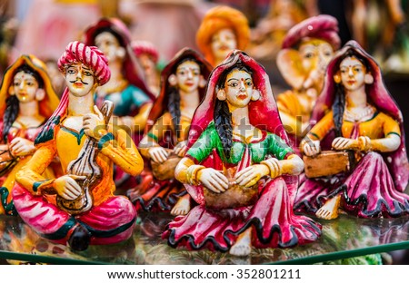 Beautiful clay dolls of miniature folk musicians performing in a band of classical Indian music - stock photo