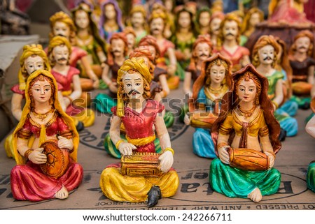 Beautiful clay dolls of miniature musicians performing in a band of classical music - stock photo