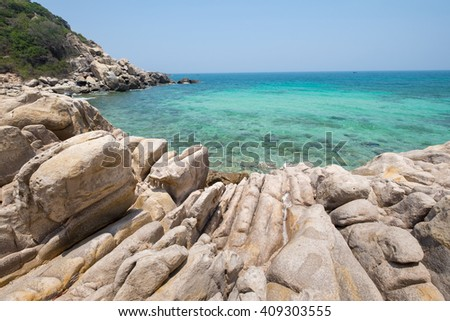 Beautiful, clean and fresh beach with rock and mountain around. Awesome place to swim, relax and enjoy in holidays. - stock photo