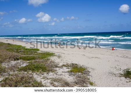 Beautiful, clean and uncrowded beach on the Atlantic Ocean in John D MacArthur State Park, on Singer Island, Florida. - stock photo